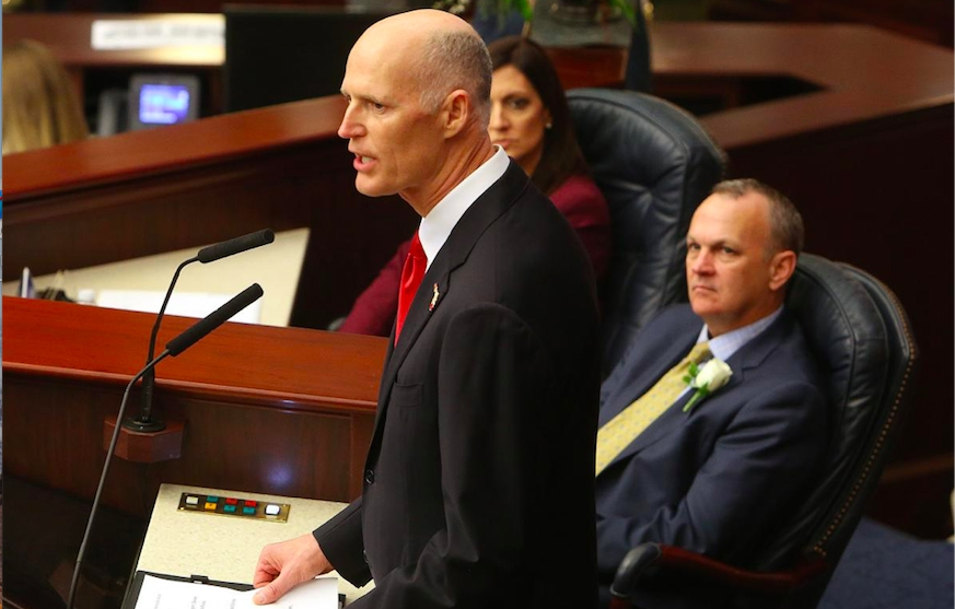 Florida Gov. Rick Scott addresses a joint session of the Florida Legislature while House Speaker Richard Corcoran, R-Land O' Lakes, watches.  (Tampa Bay Times)