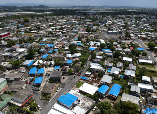 This June 18, 2018 photo shows an aerial view of the Amelia neighborhood in the municipality of Catano following Hurricane Maria in Puerto Rico. (AP)