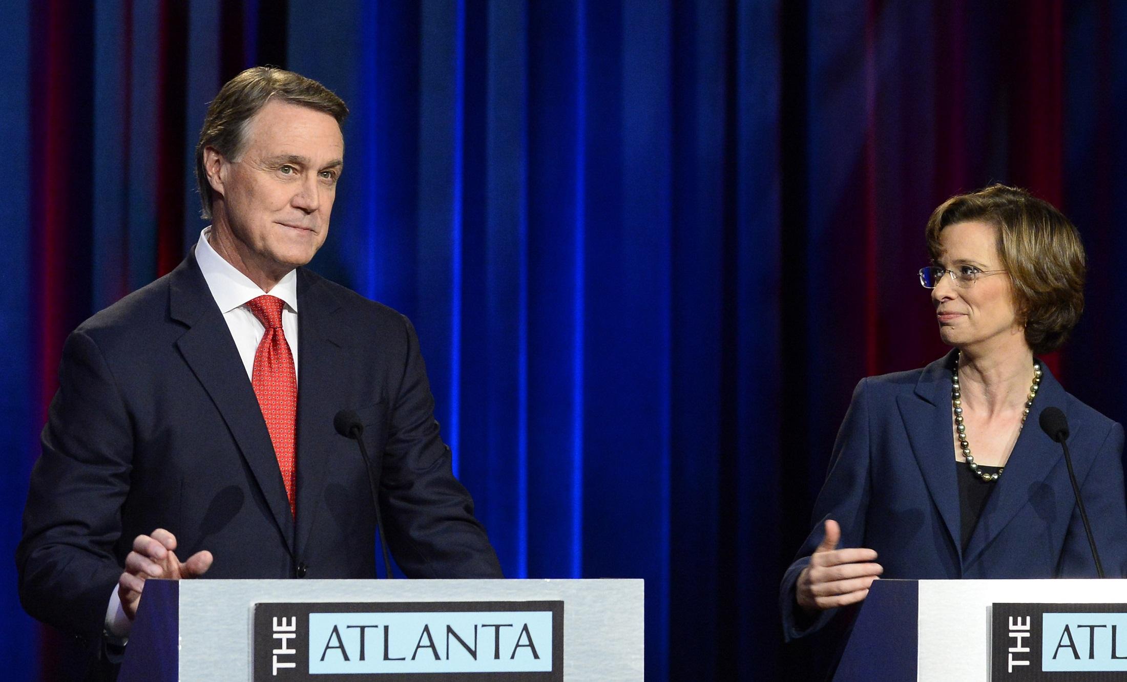 U.S. Senate hopefuls Republican David Perdue and Democrat Michelle Nunn focused mainly on two key talking points during their Atlanta Press Club debate on Oct. 26. David Tulis/ for the AJC