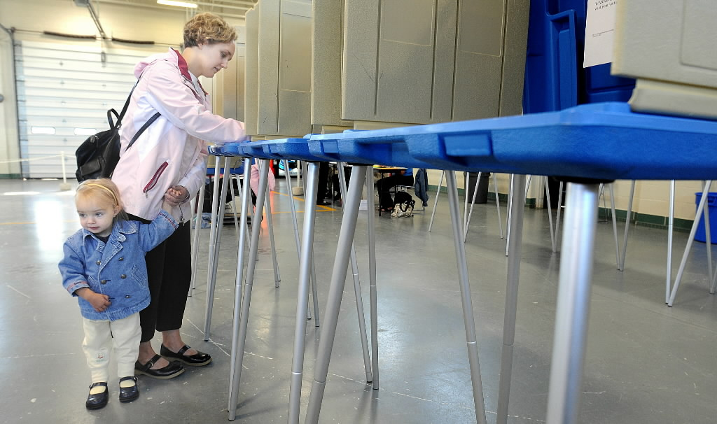 Wisconsin voters soon will be required to show photo IDs at the polls, under legislation signed by Gov. Scott Walker. This Journal Sentinel file photo shows a voter from Sussex in 2008.