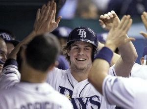 The Tampa Bay Rays' Wil Myers, the American League Rookie of the Year, high-fives his teammates in September.