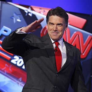 Republican presidential candidates Texas Gov. Rick Perry salutes the crowd before a Republican presidential debate Oct. 18 in Las Vegas.