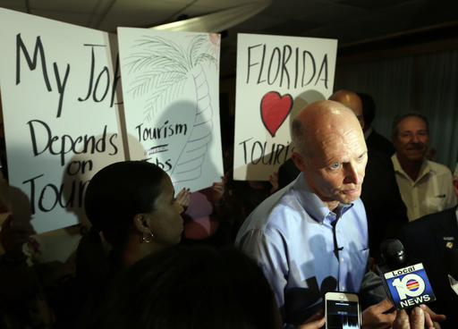 Florida Gov. Rick Scott speaks with the news media following a jobs roundtable about the economic impact of Visit Florida and Enterprise Florida, Thursday, March 2, 2017, in Hialeah, Fla. (AP)