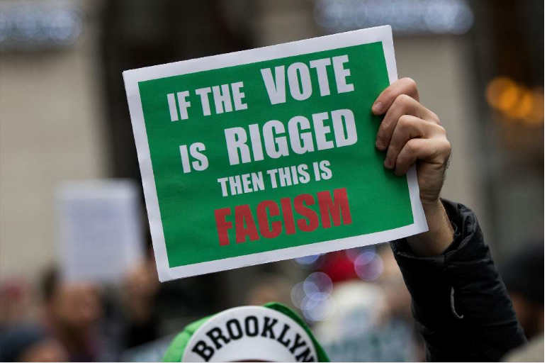 A Green Party sign at a New York City rally in support of vote recounts in Michigan, Wisconsin and Pennsylvania. (Getty Images)