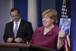 Council of Economic Advisers Chair Christina Romer holds up a copy of the 'Economic Report of the President' for 2010.