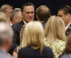 GOP presidential candidate Mitt Romney greets donors after speaking at a campaign fundraising event in Atlanta