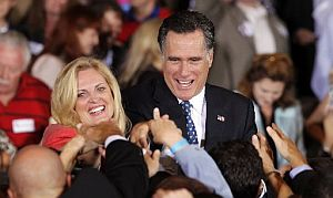 Ann and Mitt Romney greet supporters in Tampa on Tuesday after a Florida primary win.