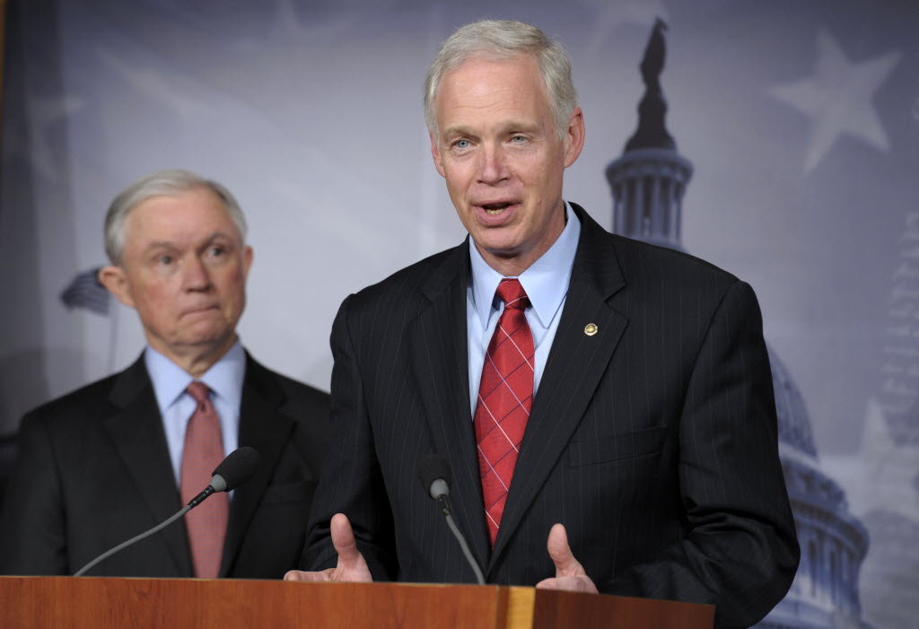 """U.S. Sen. Ron Johnson (right), shown here with Sen. Jeff Sessions, has said Democratic senators Max Baucus and Harry Reid have called the implementation of Obamacare a """"train wreck."""" So, what exactly did the two Obamacare supporters say? (AP photo)"""
