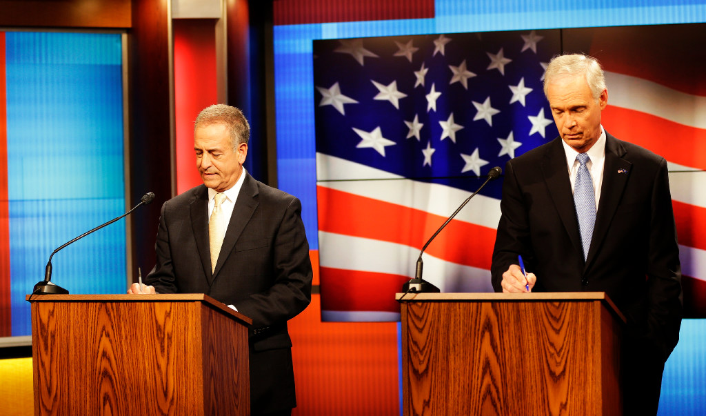 Democratic challenger Russ Feingold (left) and Republican U.S. Sen. Ron Johnson prepare for a debate in Green Bay, Wis., on Oct. 14, 2016. (Sarah Kloepping photo)