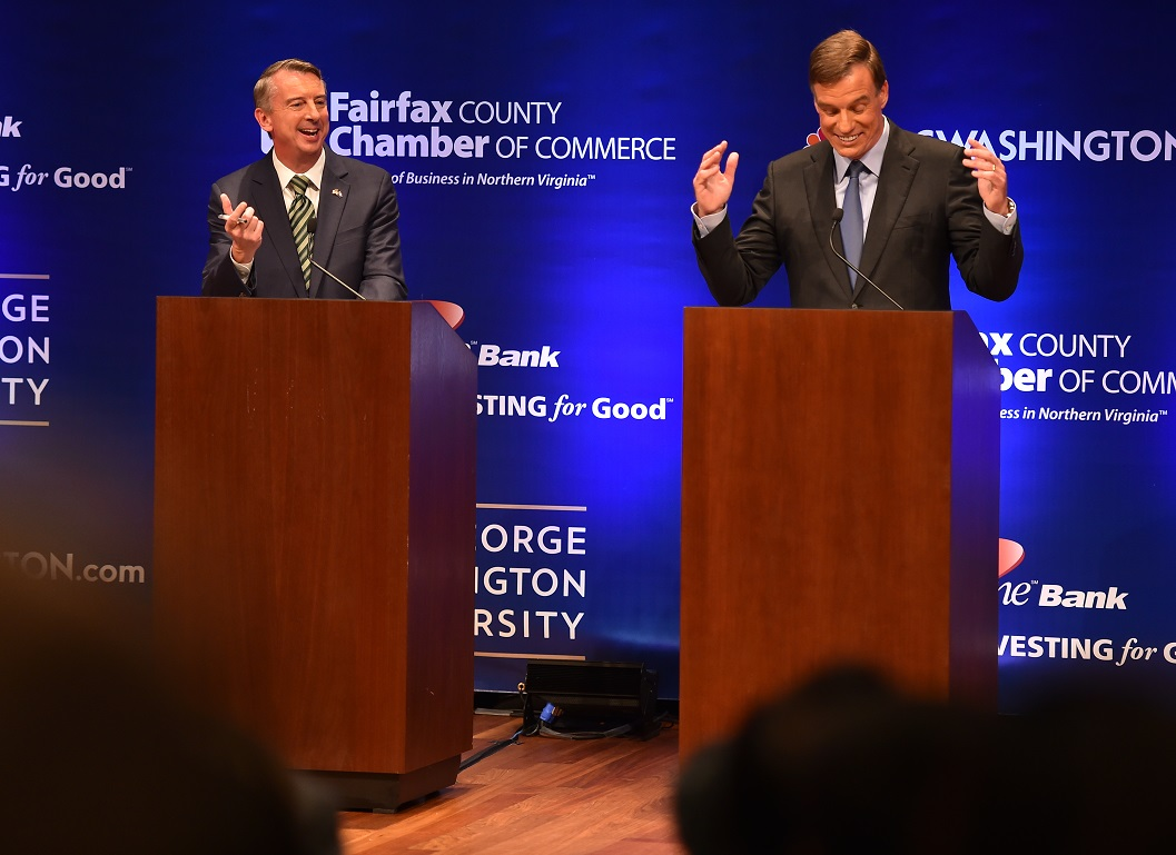 Democratic U.S. Sen. Mark Warner, right, gestures as his opponent Republican Ed Gillespie, answers a question during Tuesday evening's Virginia U.S. Senate Debate. AP Photo.
