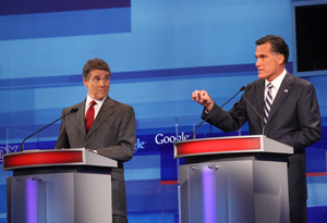 Rick Perry and Mitt Romney spar during the Fox News/Google Republican presidential debate Thursday in Orlando.