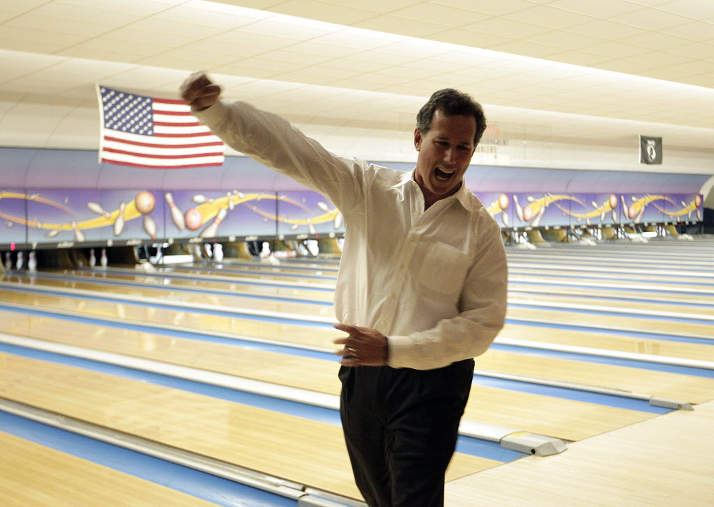 In this Associated Press photo, GOP presidential hopeful Rick Santorum celebrates bowling a strike while campaigning in Wisconsin.