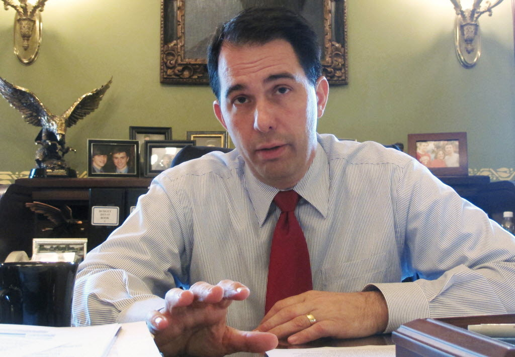 Gov. Scott Walker's position on abortion and a law he signed that restricts it are the subject of dueling TV ads in the 2014 Wisconsin gubernatorial election.