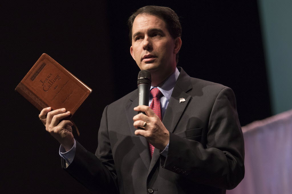 "Holding a book called ""Jesus Calling,"" Gov. Scott Walker spoke at the Iowa Faith & Freedom Coalition presidential forum on April 25, 2015. He is scheduled to return to Iowa on May 16, 2015. (AP photo)"