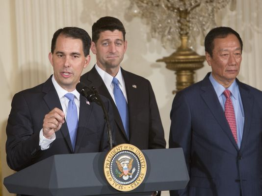 Wisconsin Gov. Scott Walker (from left), U.S. House Speaker Paul Ryan and Foxconn chairman Terry Gou appeared at the White House to announce Foxconn's plans to invest up to $10 billion to put a manufacturing plant in Wisconsin. (Chris Kleponis/CNP/TNS