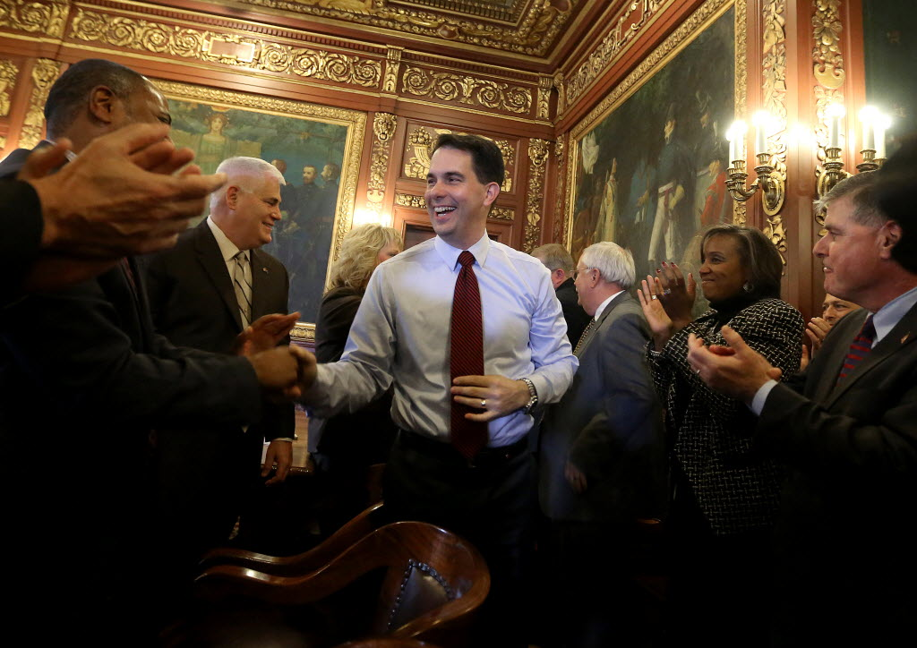 Wisconsin Gov. Scott Walker met with his Cabinet on Nov. 5, 2014, the day after he won re-election to a second term. Walker hasn't discouraged speculation that he might run for the Republican nomination for president in 2016.