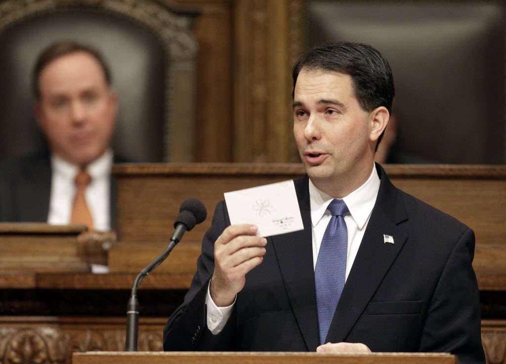 During his 2013 budget address to the Wisconsin Legislature, Gov. Scott Walker read from a card from a resident who thanked him for lower property taxes. (Mark Hoffman/Milwaukee Journal Sentinel)