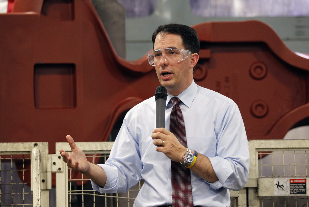 Gov. Scott Walker campaigned for re-election in 2014 at a plant in Platteville, Wis. (Milwaukee Journal Sentinel)