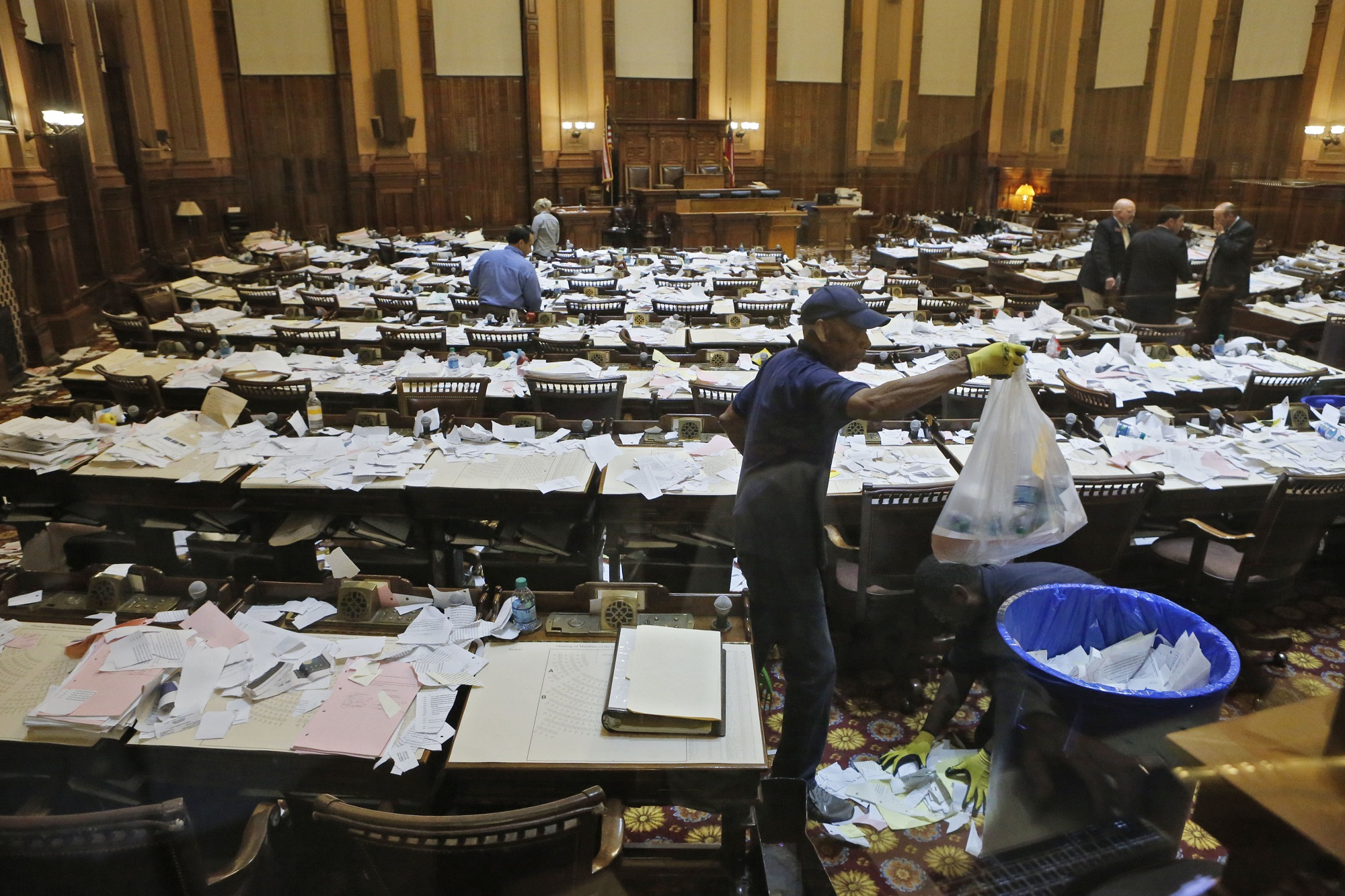 Workers clean up after the House adjourned for 2015 Legislative session. Photo by Bob Andres / AJC
