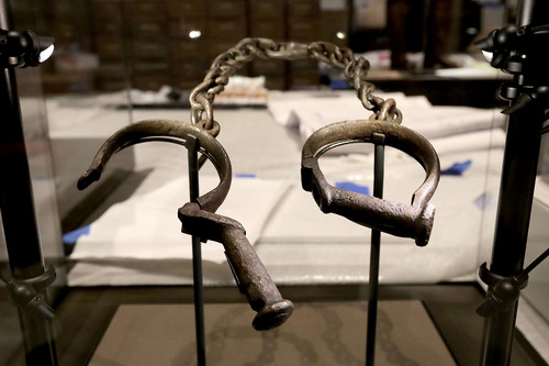 A pair of slave shackles are on display in the Slavery and Freedom Gallery in the Smithsonian's National Museum of African American History and Culture in Washington, D.C. in September 2016. (Getty Images)