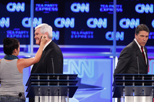 Newt Gingrich has his makeup retouched during a commercial break for the Sept. 12, 2011 CNN/Tea Party Express GOP debate in Tampa.