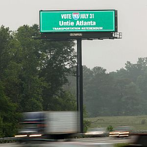 A sign urging voters to approve a tax to pay for transportation projects across metro Atlanta flashes over I-75 in Henry County.