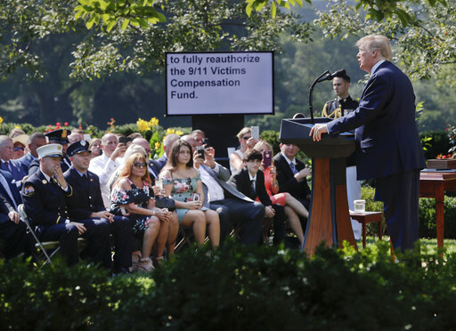 President Donald Trump speaks before signing H.R. 1327, an act ensuring that a victims' compensation fund related to the Sept. 11 attacks never runs out of money, in the Rose Garden of the White House, Monday, July 29, 2019, in Washington. (AP)