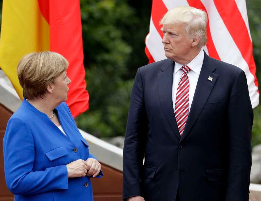 German Chancellor Angela Merkel, left, speaks with President Donald Trump during a group photo at the G7 Summit in Taormina, Italy, on May 26, 2017. (AP/Andrew Medichini)