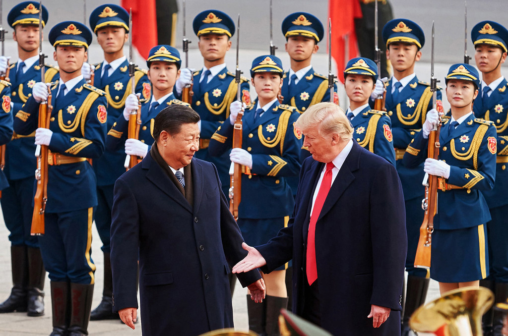 China's President Xi Jinping and U.S. President Donald Trump shake hands on Nov. 9, 2017, during a meeting in Beijing. The two are now at the center of a trade war with tariffs imposed on both sides.  (Artyom Ivanov/Tass/Abaca Press/TNS)