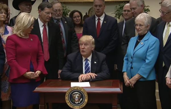 Donald Trump signs legislation rolling back federal regulations on March 27, 2017.