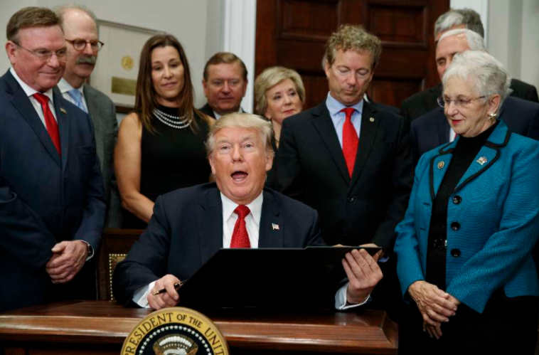 President Donald Trump signs executive order to expand association health plans. (AP)