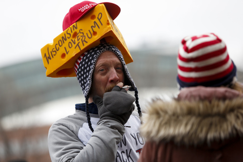 An attendee smokes a cigarette, while waiting in line to attend a rally held by U.S. President Donald Trump Jan.14, 2020 at UW-Milwaukee Panther Arena in Milwaukee, Wisconsin. (Getty Images).