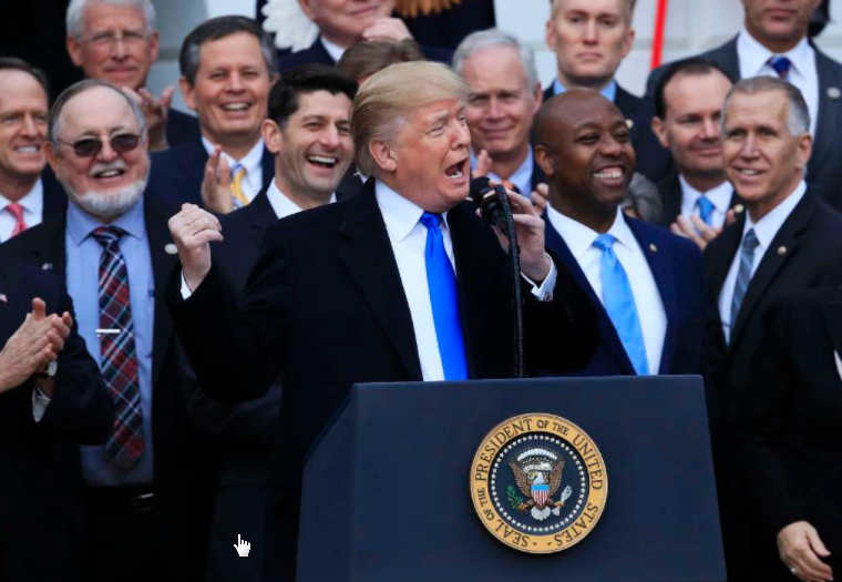 President Donald Trump celebrates passage of major tax legislation but health savings accounts supporters say it held no changes for them. (AP)