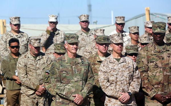 The commander of NATO and U.S. forces in Afghanistan, Army Gen. John W. Nicholson, first left, and his colleagues take part in a change of command ceremony in Afghanistan, on Jan. 15, 2018. (AP/Massoud Hossaini)