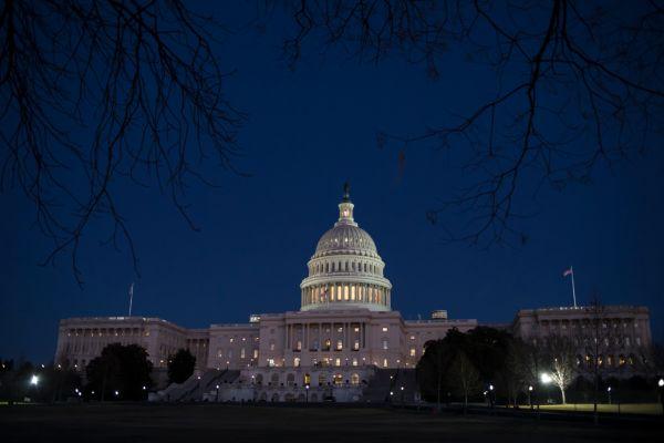 The U.S. Capitol is illuminated on Jan. 19, 2018. (AP/J. Scott Applewhite)