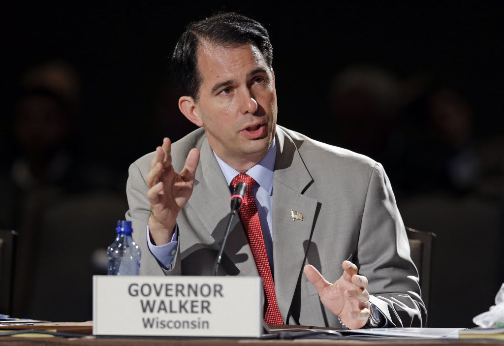 Wisconsin Gov. Scott Walker speaks during a meeting on jobs and education at the National Governors Association convention Saturday, July 12, 2014, in Nashville, Tenn.