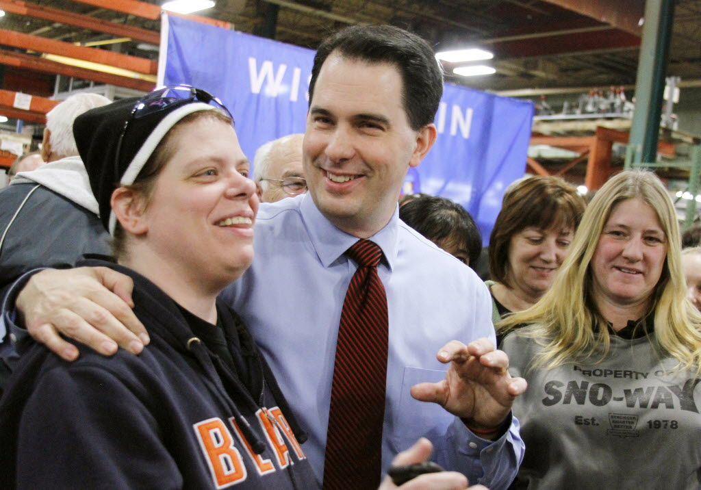 Gov. Scott Walker will welcome the National Governors Association convention in Milwaukee this weekend. In this Associated Press photo from January 2013, Walker visited a factory in Hartford, Wis.