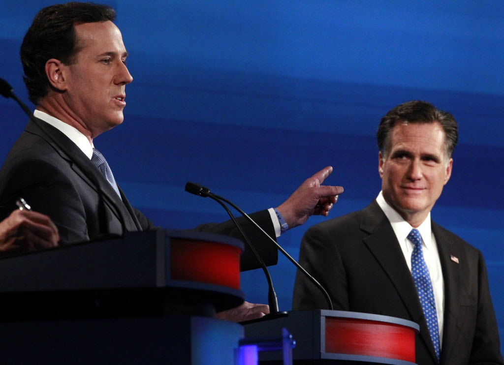 In this Associated Press photo, GOP presidential candidates Rick Santorum and Mitt Romney participate in a debate in South Carolina. They face off again April 3, 2012 in primaries in Wisconsin, Maryland and D.C.