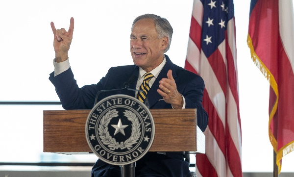 Texas Gov. Greg Abbott, offering a hook 'em Horns at an August 2018 event, hasn't fulfilled his campaign promise to place five Texas universities into the nation's top 10, PolitiFact Texas found (STEPHEN SPILLMAN, for Austin American-Statesman).