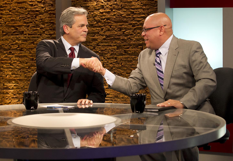 Mayoral aspirants Steve Adler and Mike Martinez shake at their Nov. 19, 2014, debate at TWC News.
