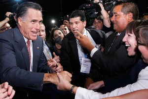 Mitt Romney greets crowd members at NALEO's conference in Florida June 21, 2012 (Photo by The Associated Press).