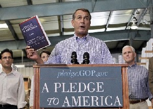 "John Boehner of Ohio, who went on to become Speaker of the House, holds up a copy of the GOP agenda, ""A Pledge to America,"" in 2010."