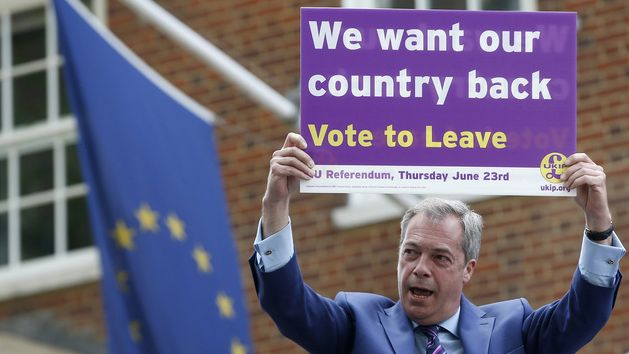 British politician and leader of the UKIP party Nigel Farage holds up a placard as he launches his party's campaign for Britain to leave the EU, outside the EU representative office in London. (AP)