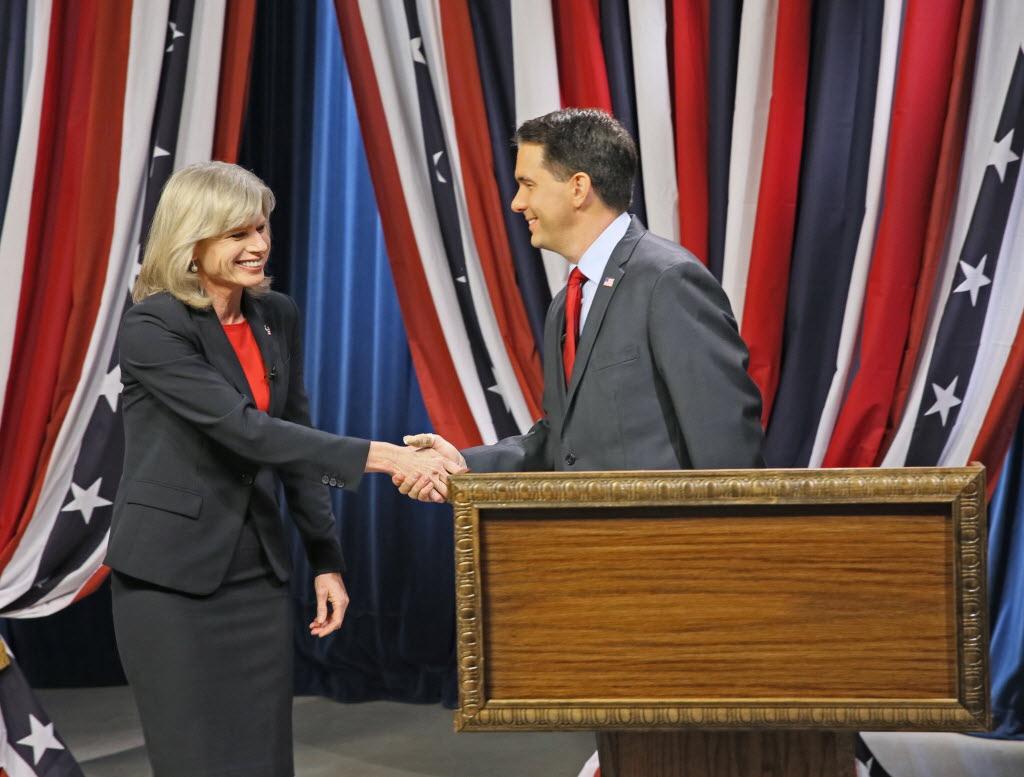 Mary Burke and Gov. Scott Walker shook hands before their final debate on Oct. 17, 2014. JS Photo Michael Sears