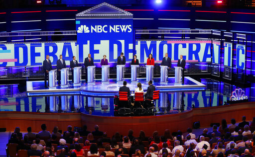 Democratic presidential candidates before the start of a Democratic primary debate Wednesday, June 26, 2019, in Miami (AP).