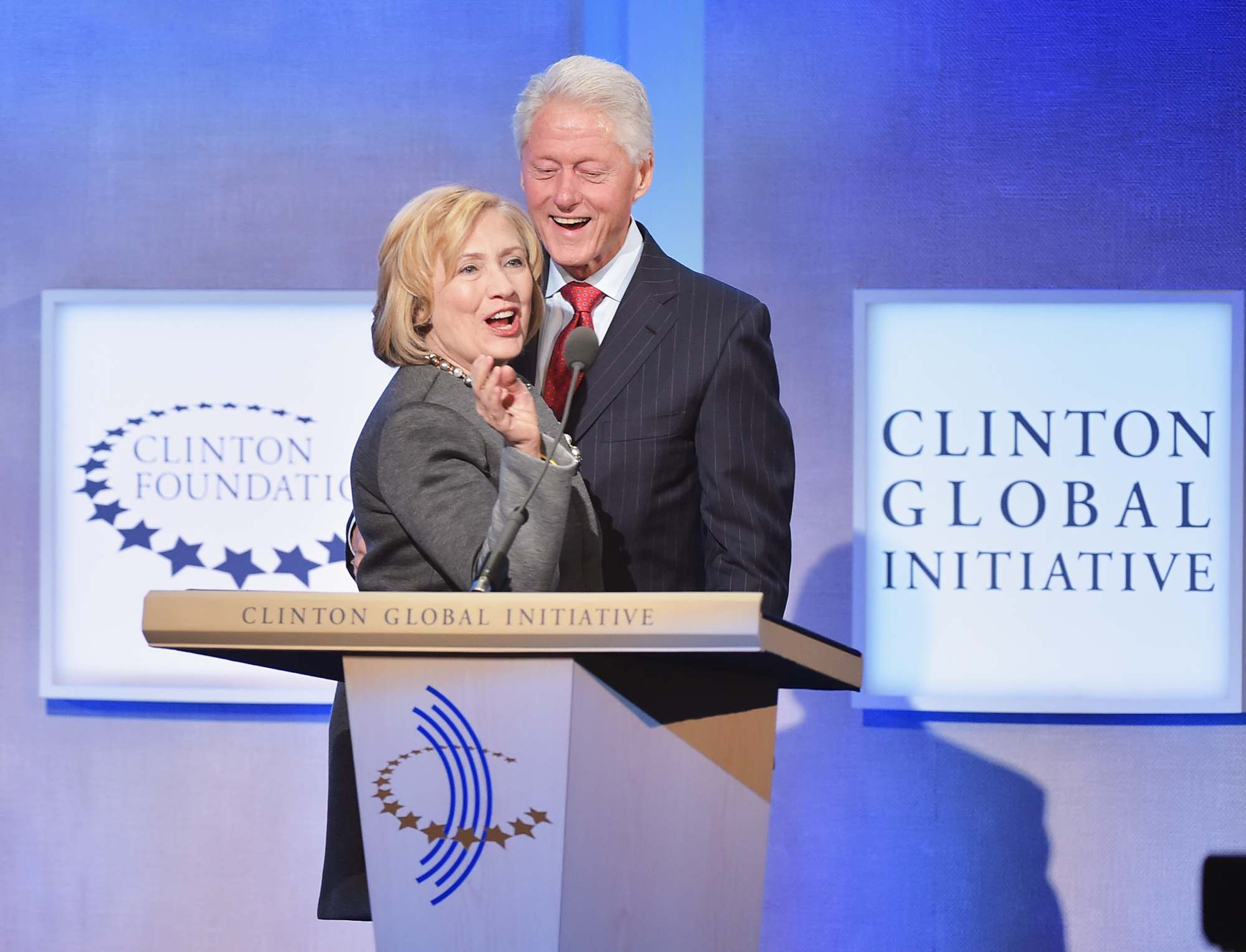 In this Sept. 22, 2014 file photo, former Secretary of State Hillary Clinton and former President Bill Clinton address the audience at the annual Clinton Global Initiative meeting in New York City. (Photo by Michael Loccisano/Getty Images)