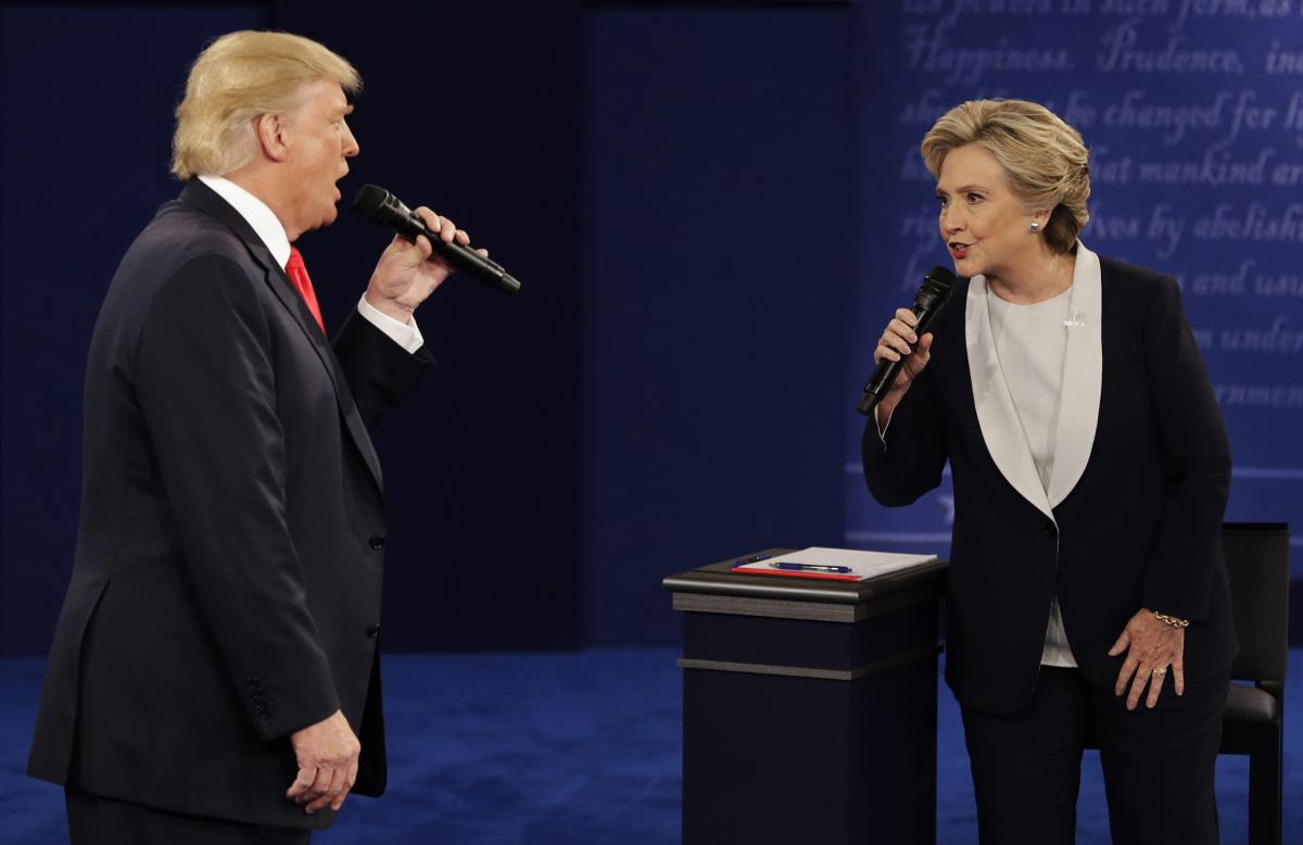 Republican presidential nominee Donald Trump and Democratic presidential nominee Hillary Clinton speak during the second presidential debate at Washington University in St. Louis on Oct. 9, 2016. (New York Times)