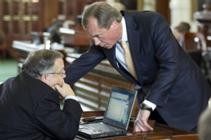 David Dewhurst talks to state Sen. John Carona in May (Austin American-Statesman photo by Jay Janner).