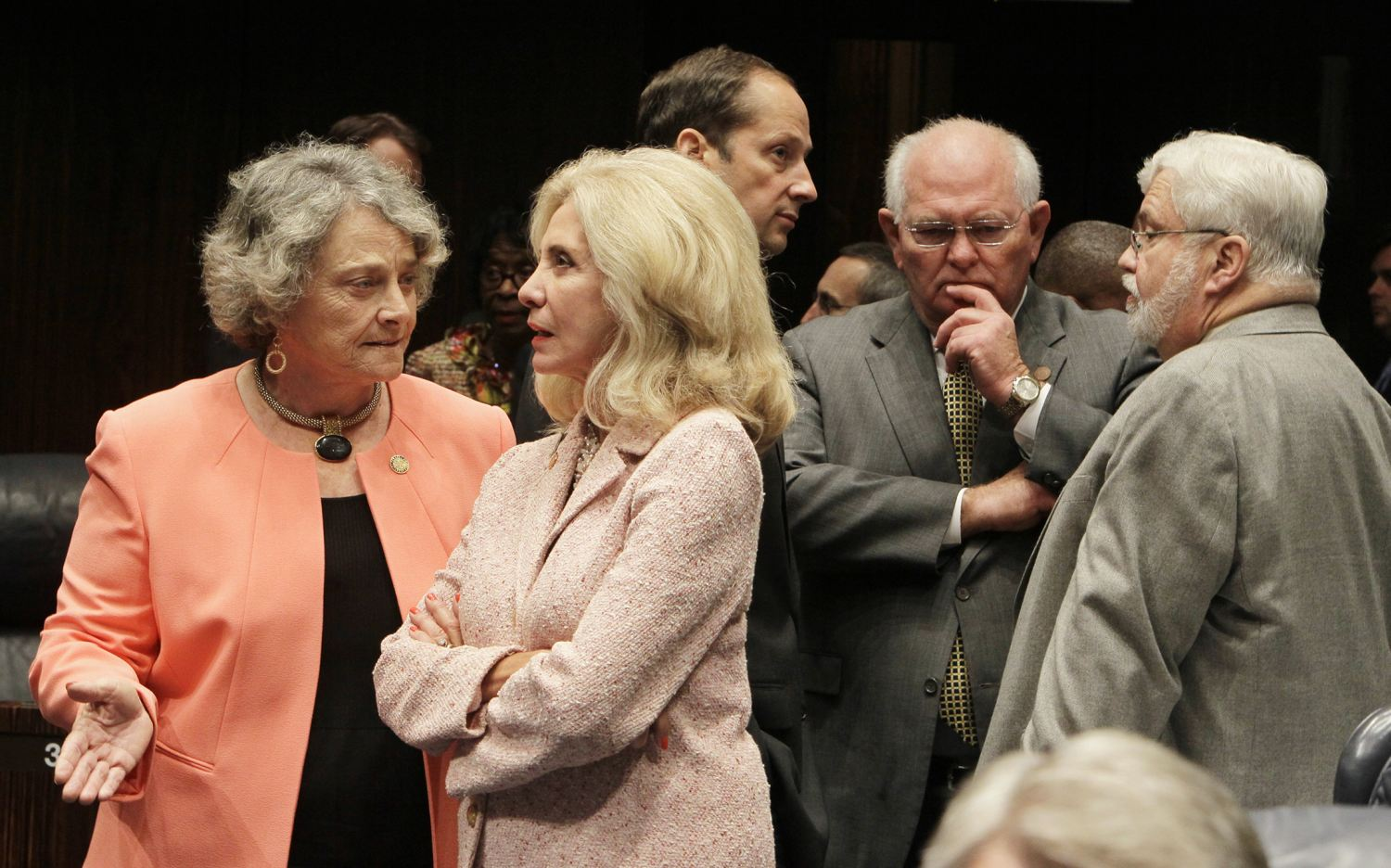 As word spread through the Florida Senate on April 28 that the Florida House had Sine Die for the 2015 session, Florida Senators huddle. Left to Right are Sens. Nancy Detert, Maria Sachs, Joe Negron, Bill Montford, and Jack Latvala. (Tampa Bay Times)
