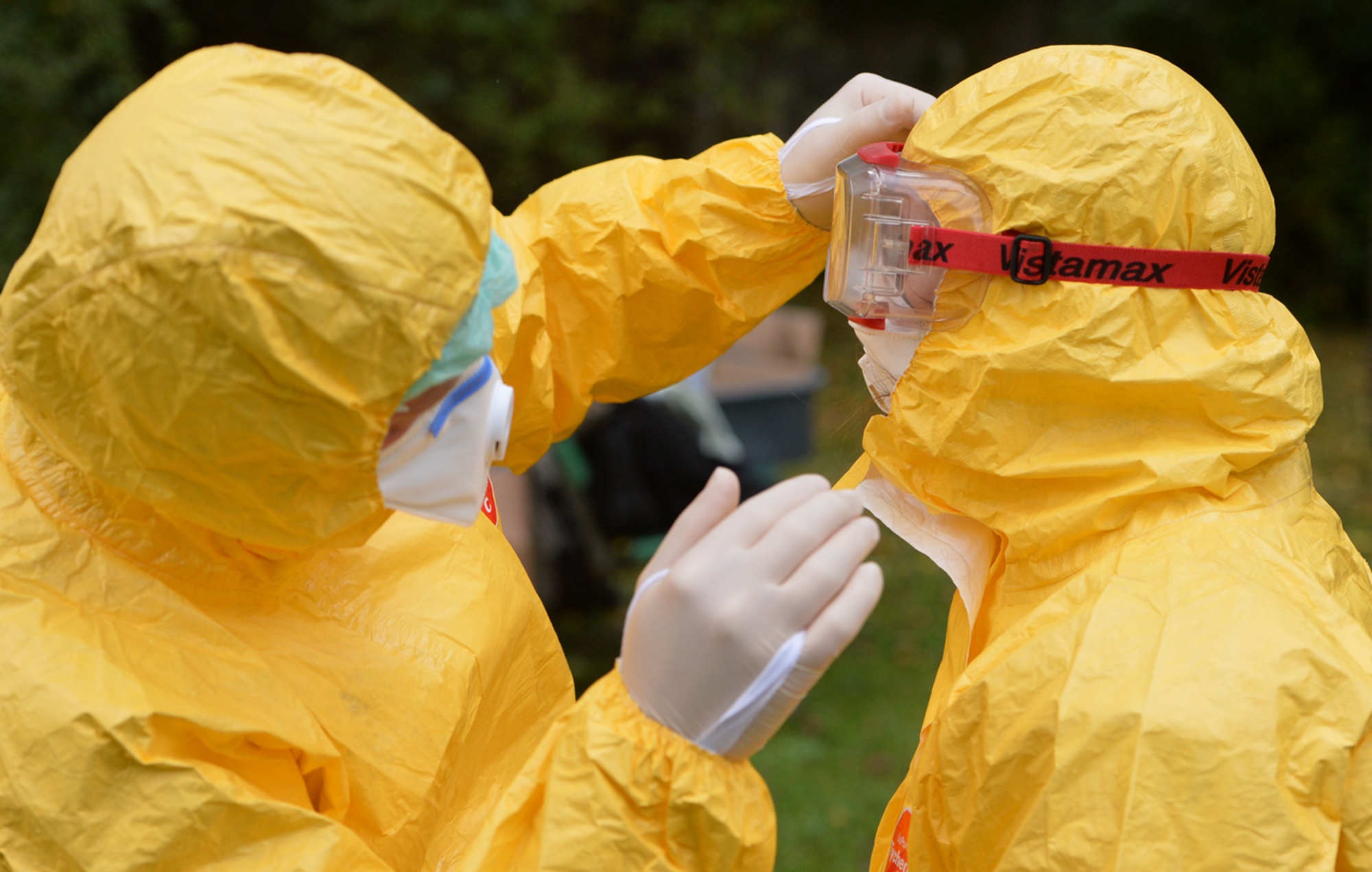The deadliness of Ebola that has doctors like this one in Germany donning full body protection has spurred conspiracy theories in the United States. (Getty Images)